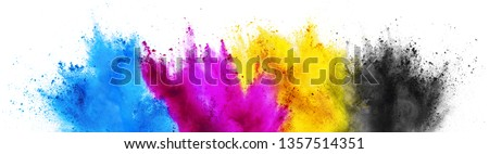 colorful CMYK cyan magenta yellow key holi paint color powder explosion print concept isolated on white background Royalty-Free Stock Photo #1357514351