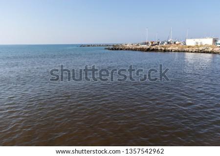 NEA MOUDANIA, GREECE - MARCH 31, 2019: Coastal street of town of Nea Moudania, Chalkidiki, Central Macedonia, Greece #1357542962