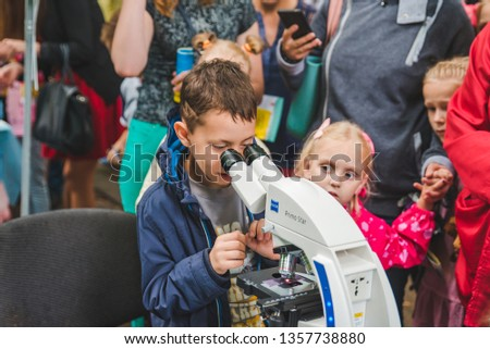 LVIV, UKRAINE - July 17,2018: families with kids walking by park. professional kids day holidays #1357738880