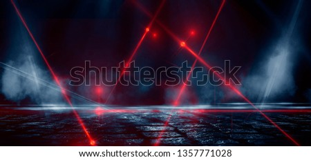 Dark street, reflection of neon light on wet asphalt. Rays of light and red laser light in the dark. Night view of the street, the city. Abstract dark blue background. #1357771028
