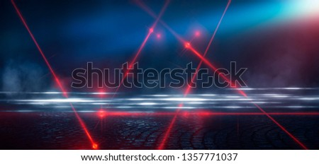 Dark street, reflection of neon light on wet asphalt. Rays of light and red laser light in the dark. Night view of the street, the city. Abstract dark blue background. #1357771037