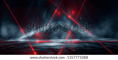 Dark street, reflection of neon light on wet asphalt. Rays of light and red laser light in the dark. Night view of the street, the city. Abstract dark blue background. Royalty-Free Stock Photo #1357771088