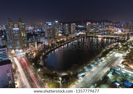 SEOUL, KOREA - MARCH, 2019: Night view of lake Seokchon and Jamsil area in Seoul #1357779677