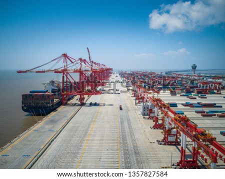 Container ship in export and import business and logistics. Shipping cargo to harbor by crane. Water transport International. Aerial view #1357827584