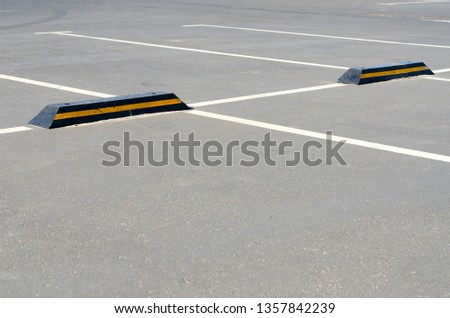 Road marking of parking spaces at supermarket #1357842239