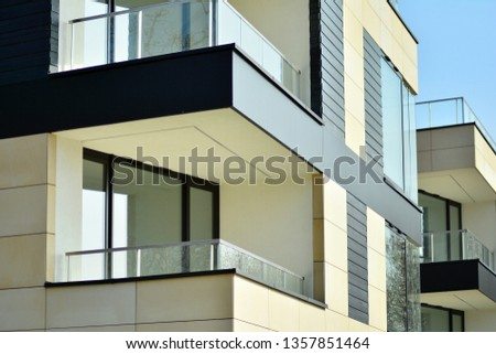 Fragment of a modern apartment building in front. Very modern apartment house. #1357851464