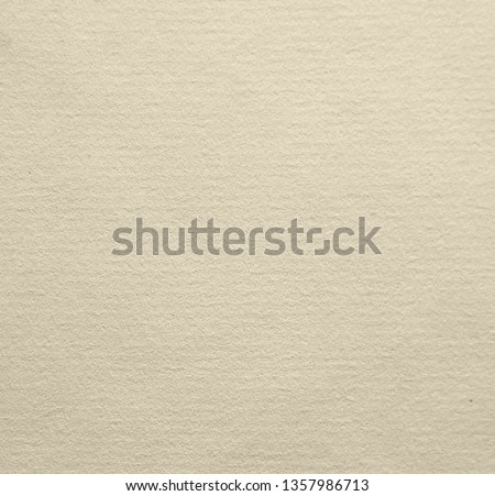 Texture of the surface of a yellowed sheet of ancient laid paper.  Laid paper is a type of paper having a ribbed texture imparted by the manufacturing process
