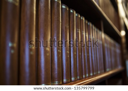 Book shelf in a church library full with brown books