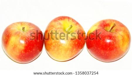 Three apples on white background #1358037254