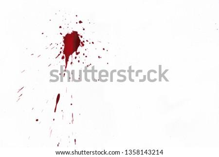Blood splatters on white background #1358143214