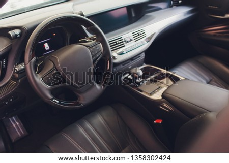 car interior. Modern car speedometer and illuminated dashboard. Luxurious car instrument cluster. Close up shot of car instrument panel. #1358302424