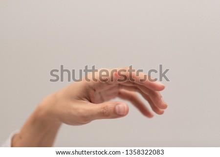 Red spot on women hand. #1358322083
