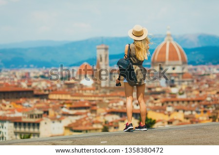 Florence Europe Italia travel summer tourism holiday vacation background -young  girl with camera in hand standing on the hill looking on the cathedral #1358380472