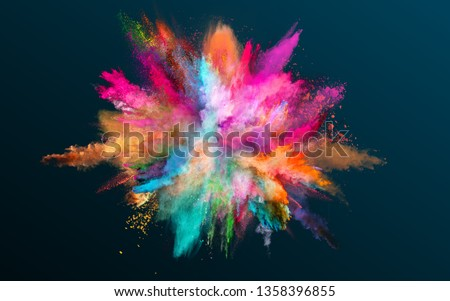 Colored powder explosion on black background. Freeze motion. #1358396855