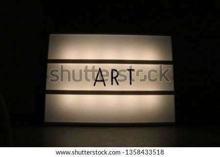 backlit art sign
