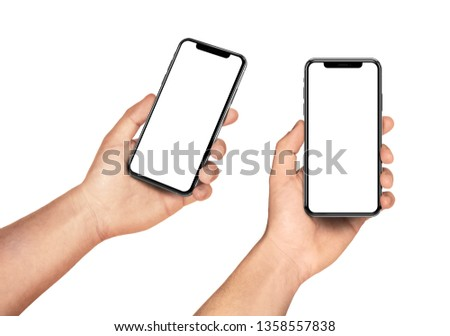 Man hand holding the black smartphone set with blank screen and modern frame less design - isolated on white background #1358557838