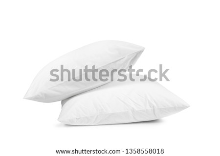 Two white pillows isolated, pillows on a white background, two pillows piled against white background #1358558018