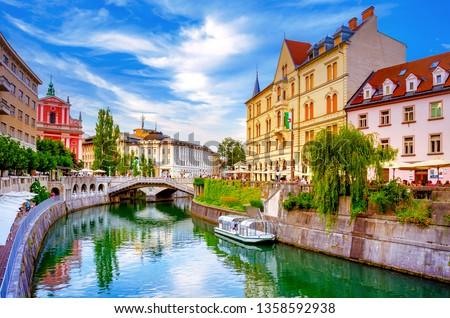 Slovenia Ljubljana Tromostovje Ljublianica river Church Royalty-Free Stock Photo #1358592938