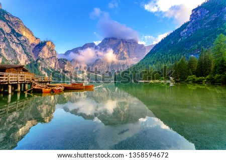 Spectacular romantic place with typical wooden boats on the alpine lake,(Lago di Braies) Braies lake,Dolomites,South Tyrol,Italy,Europe #1358594672