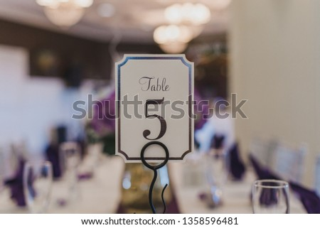 Wedding Reception table number five place card on puple table se