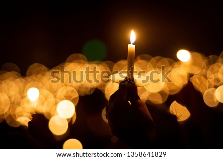 Hand holding candle Royalty-Free Stock Photo #1358641829
