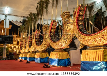 Ancient Thai music instrument and band are played by student in temple event at the night. #1358664392