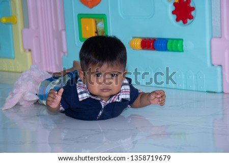 Cute little asian baby boy lying on soft blanket #1358719679