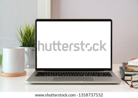 Laptop on white wooden business workspace desk #1358737532