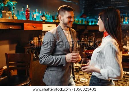 Love couple talking at bar counter #1358823401