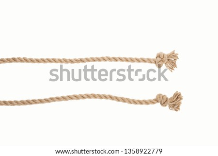 lines of brown jute ropes with knots isolated on white  #1358922779
