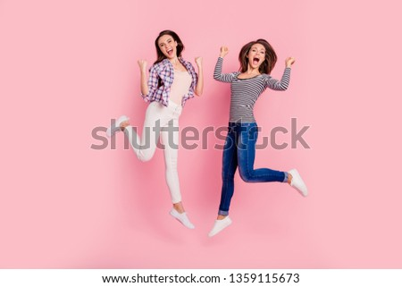 Full length body size view photo of childish playful careless ladies fooling isolated funny funky hipsters wearing jeans shirts on rose-colored background #1359115673