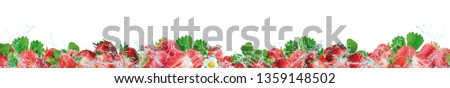 Strawberries and splashing water on a white background. #1359148502