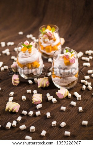 Dessert in a glass with marshmallows. #1359226967