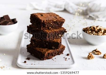 homemade chocolate brownies with walnuts on white background #1359269477