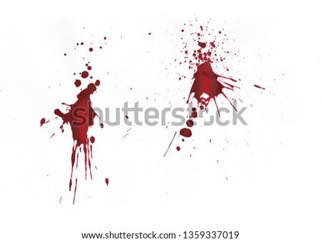 Blood splatters on white background #1359337019