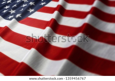 US Flag wrinkled cloth foreground out of focus #1359456767