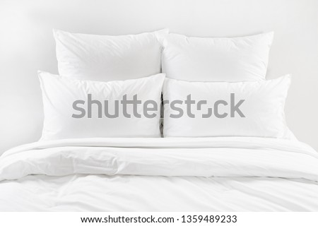 White bed isolated, white bed linen isolated, bed with pillows isolated, four white pillows and duvet on a bed, bedroom interior with a white bedding #1359489233