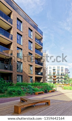 Benches at Modern architectural complex of apartment residential buildings. And outdoor facilities. #1359642164