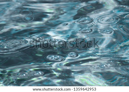 Water background for design 5. Clear clear blue water with highlights and bubbles. blurred water background. ripples and sparks on water