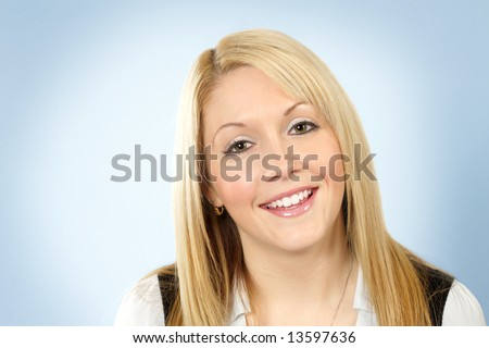 An cute friendly blonde girl smiling for the camera. #13597636