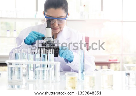 Science Concept. Laboratory Research and Development. Scientific glassware for chemical experiment. Microscope, laboratory beakers, test tubes, pipettes. Lab interior background. Royalty-Free Stock Photo #1359848351