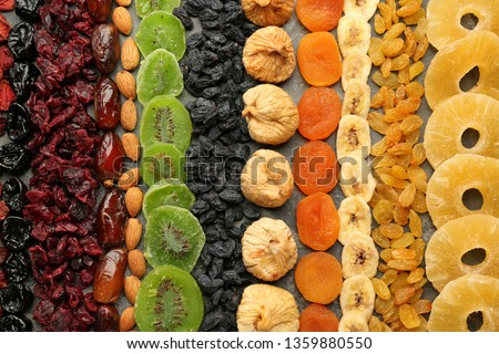 Assortment of tasty dried fruits on grey background #1359880550
