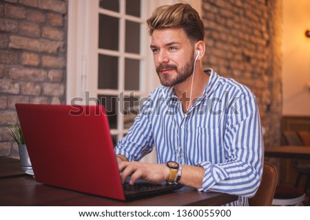 Millennial freelancer working at the cofee shop #1360055900