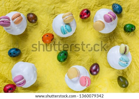 Easter mini cupcakes are decorated with mini macaroons. Easter. For kids. #1360079342