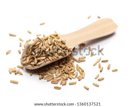Peeled oat grains with wooden spoon isolated on white background #1360137521