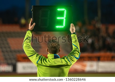 Technical referee shows 3 minutes added time during the football match. #1360228646
