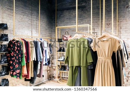 Fashion stylish luxury clothes display. Image and stylish services, selection of colors, types. Capsule spring wardrobe Royalty-Free Stock Photo #1360347566