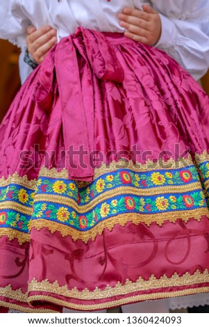 Detail of traditional Slovak folk costume worn by women of ethnic Slovakian from Banat area, Romania. #1360424093