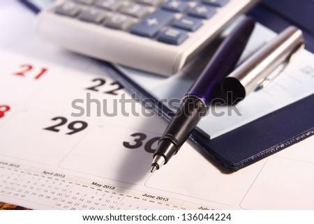 Pen, Calculator, Calendar and Cheque Book Photo of a pen, calculator, calendar and cheque book