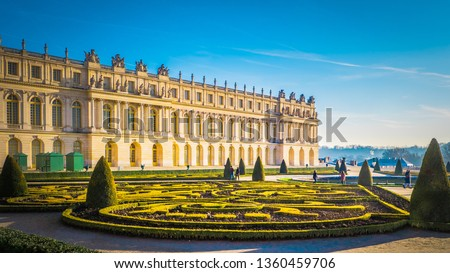 Famous palace Versailles with beautiful gardens outdoors near Paris, France. The Palace Versailles was a royal chateau and was added to the UNESCO list of World Heritage Sites.  #1360459706